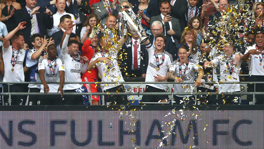 LONDON, ENGLAND - MAY 26:  Kevin McDonald of Fulham and Tom Cairney of Fulham lift the trophy following their sides victory in the Sky Bet Championship Play Off Final between Aston Villa and  Fulham at Wembley Stadium on May 26, 2018 in London, England.  (Photo by Clive Mason/Getty Images)