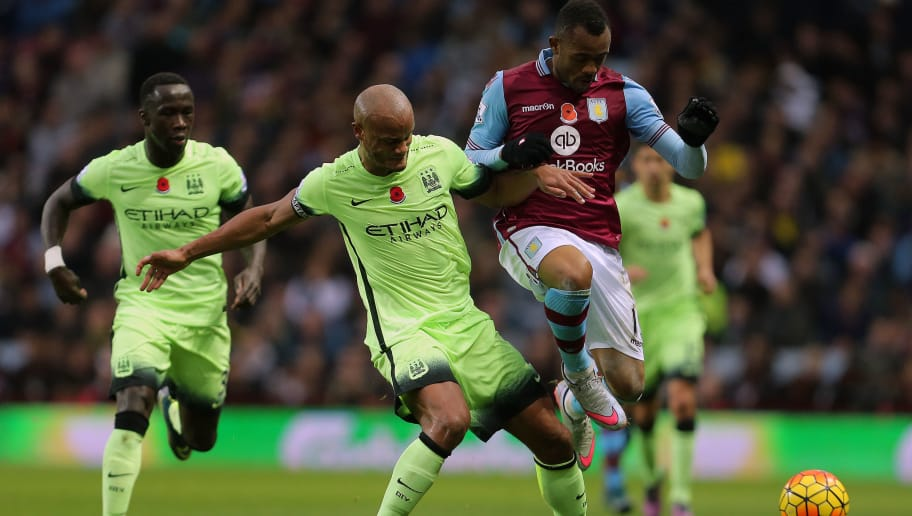 BIRMINGHAM, ENGLAND - NOVEMBER 08:  Vincent Company of Manchester City and Jordan Ayew of Aston Villa during the Barclays Premier League match between Aston Villa and Manchester City at Villa Park on November 8, 2015 in Birmingham, England.  (Phoyo by James Baylis - AMA/Getty Images)