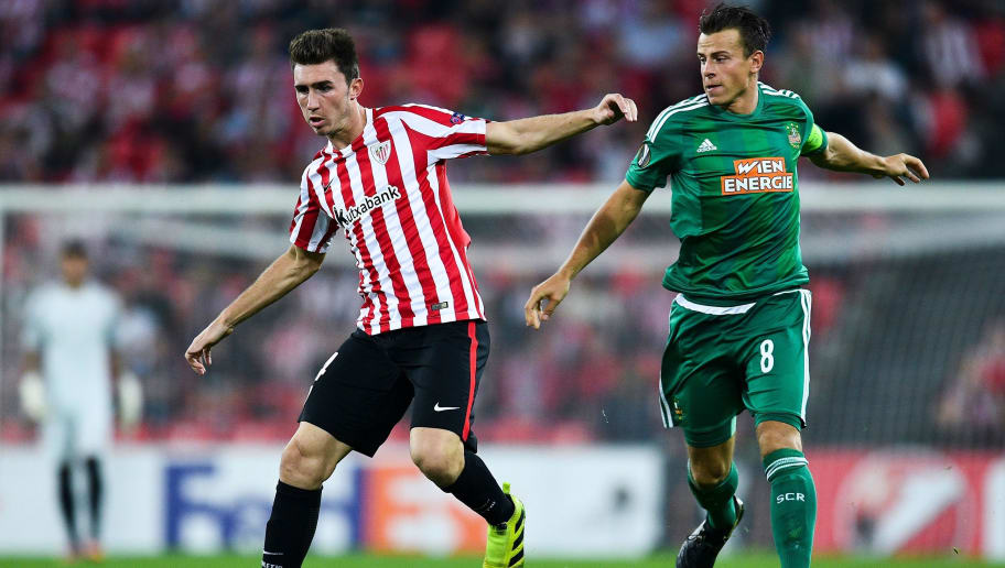 BILBAO, SPAIN - SEPTEMBER 29:  Aymeric Laporte of Athletic Club competes for the ball with Stefan Schwab of SK Rapid Wien during the UEFA Europa League Group F match between Athletic Club and SK Rapid Wien at San Mames stadium on September 29, 2016 in Bilbao, Spain.  (Photo by David Ramos/Getty Images)