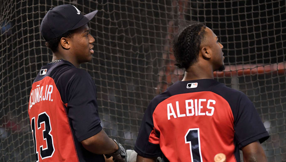 PHOENIX, AZ - SEPTEMBER 08:  Ronald Acuna Jr. #13 and Ozzie Albies #1 of the Atlanta Braves look on during batting practice for the MLB game against the Arizona Diamondbacks at Chase Field on September 8, 2018 in Phoenix, Arizona.  (Photo by Jennifer Stewart/Getty Images)