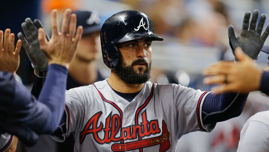 MIAMI, FL - MAY 11:  Nick Markakis #22 of the Atlanta Braves high fives his teammates after scoring in the fourth inning against the Miami Marlins at Marlins Park on May 11, 2018 in Miami, Florida.  (Photo by Michael Reaves/Getty Images)