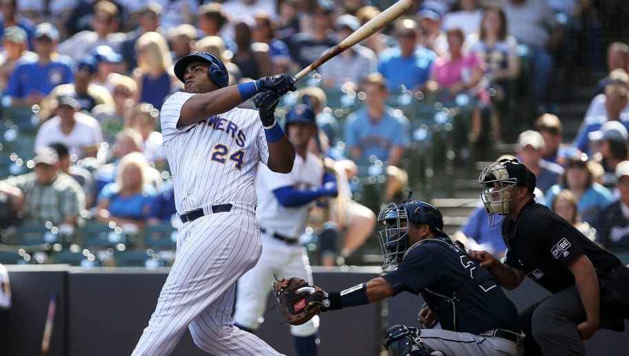 MILWAUKEE, WI - JULY 08:  Jesus Aguilar #24 of the Milwaukee Brewers hits a home run in the eighth inning against the Atlanta Braves at Miller Park on July 8, 2018 in Milwaukee, Wisconsin.  (Photo by Dylan Buell/Getty Images)