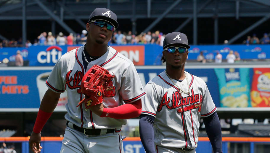 NEW YORK, NY - AUGUST 05:  Ronald Acuna Jr. #13 (L) and Ozzie Albies #1 of the Atlanta Braves look on before a game against the New York Mets at Citi Field on August 5, 2018 in the Flushing neighborhood of the Queens borough of New York City. The Braves defeated the Mets 5-4 after ten innings.  (Photo by Jim McIsaac/Getty Images)