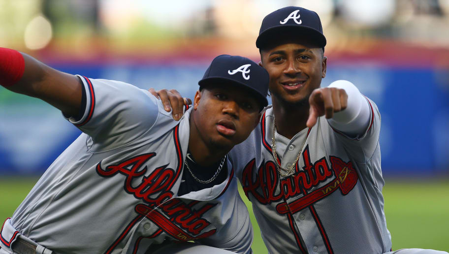 NEW YORK, NY - AUGUST 03:  Ronald Acuna Jr. #13 and Ozzie Albies #1 of the Atlanta Braves joke around prior to the start of the game against the New York Mets  Citi Field on August 3, 2018 in the Flushing neighborhood of the Queens borough of New York City. Atlanta Braves defeated the New York Mets 2-1.  (Photo by Mike Stobe/Getty Images)
