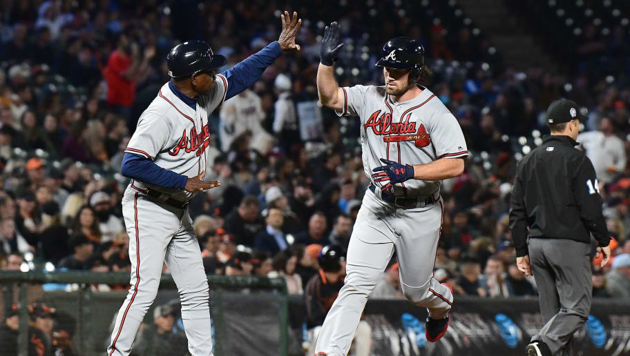 SAN FRANCISCO, CA - SEPTEMBER 11:  Charlie Culberson #16 of the Atlanta Braves is congratulated by third base coach Ron Washington #37 after Culberson hit a two-run home run against the San Francisco Giants in the top of the fifth inning at AT&T Park on September 11, 2018 in San Francisco, California.  (Photo by Thearon W. Henderson/Getty Images)