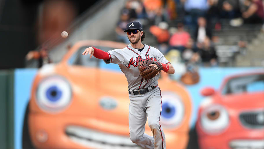 SAN FRANCISCO, CA - SEPTEMBER 12:  Dansby Swanson #7 of the Atlanta Braves throws to first base throwing the runner out against the San Francisco Giants in the bottom of the ninth inning at AT&T Park on September 12, 2018 in San Francisco, California.  (Photo by Thearon W. Henderson/Getty Images)