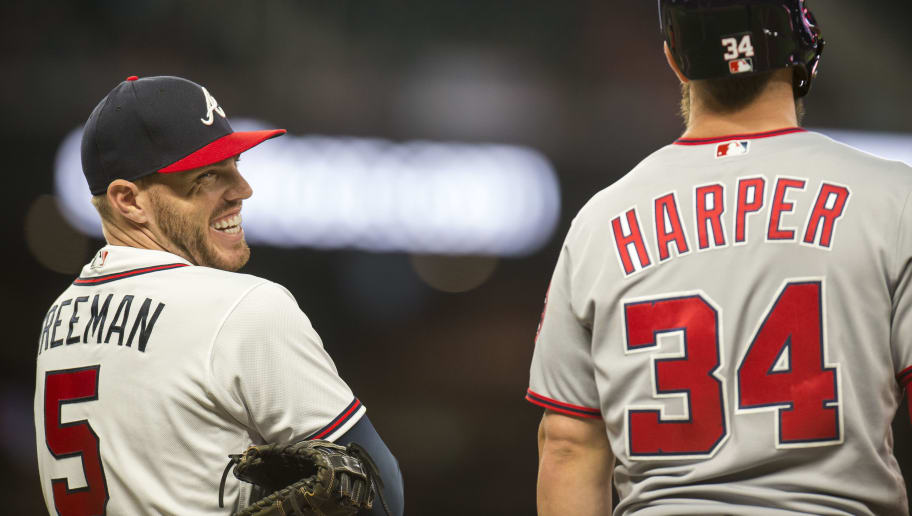 ATLANTA, GA - APRIL 2: Freddie Freeman #5 of the Atlanta Braves smiles and talks to Bryce Harper during the game against the Washington Nationals at SunTrust Park on April 2, 2018, in Atlanta, Georgia. (Photo by Patrick Duffy/Beam Imagination/Atlanta Braves/Getty Images) *** Local Caption *** Freddie Freeman,Bryce Harper