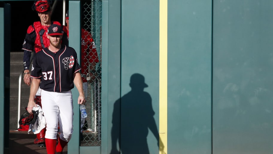 WASHINGTON, DC - JULY 20: Starting pitcher Stephen Strasburg #37 of the Washington Nationals walks from the bullpen to the dugout before a game against the Atlanta Braves at Nationals Park on July 20, 2018 in Washington, DC. (Photo by Patrick McDermott/Getty Images)