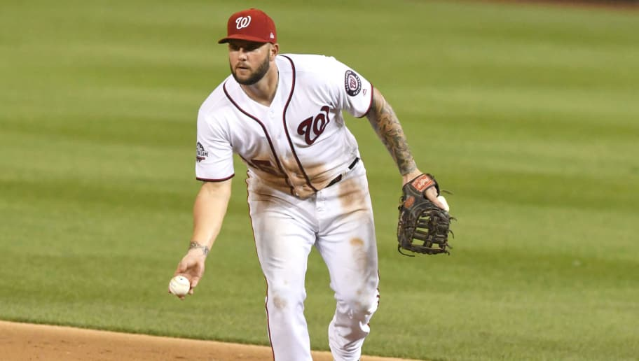 WASHINGTON, DC - AUGUST 08:  Matt Adams #15 of the Washington Nationals fields a ground ball during a baseball game against the Atlanta Braves at Nationals Park on August 8, 2018 in Washington, DC.  (Photo by Mitchell Layton/Getty Images)