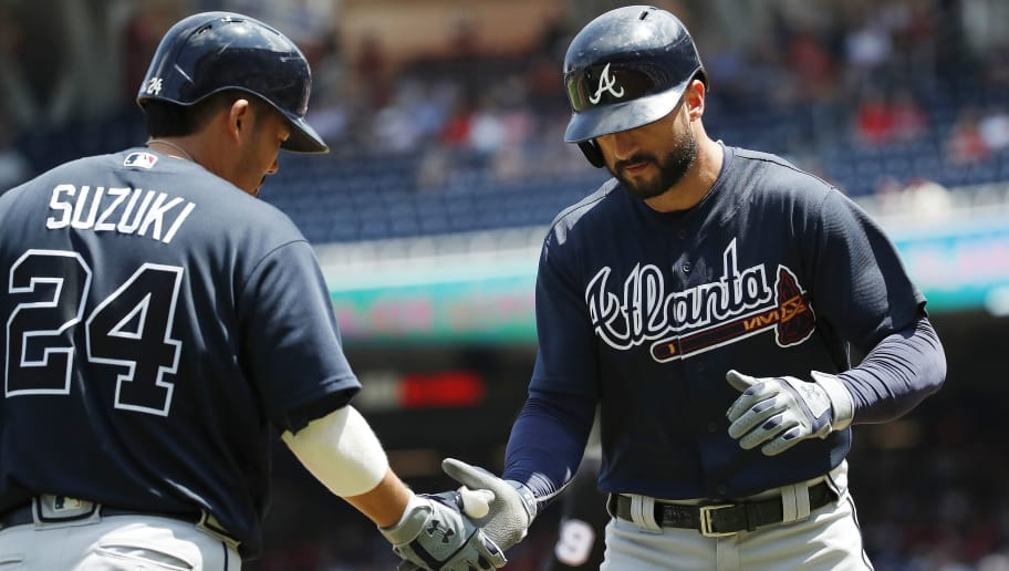 WASHINGTON, DC - AUGUST 09: Nick Markakis #22 of the Atlanta Braves celebrates with Kurt Suzuki #24 after hitting a solo home run in the second inning against the Washington Nationals at Nationals Park on August 9, 2018 in Washington, DC. (Photo by Patrick McDermott/Getty Images)