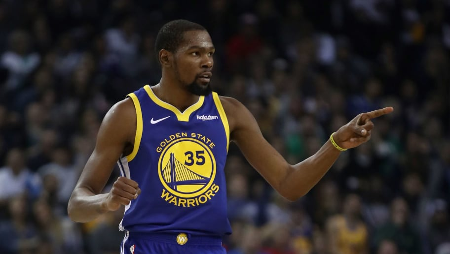 OAKLAND, CA - NOVEMBER 13:  Kevin Durant #35 of the Golden State Warriors reacts after the Warriors made a basket against the Atlanta Hawks at ORACLE Arena on November 13, 2018 in Oakland, California.  NOTE TO USER: User expressly acknowledges and agrees that, by downloading and or using this photograph, User is consenting to the terms and conditions of the Getty Images License Agreement.  (Photo by Ezra Shaw/Getty Images)