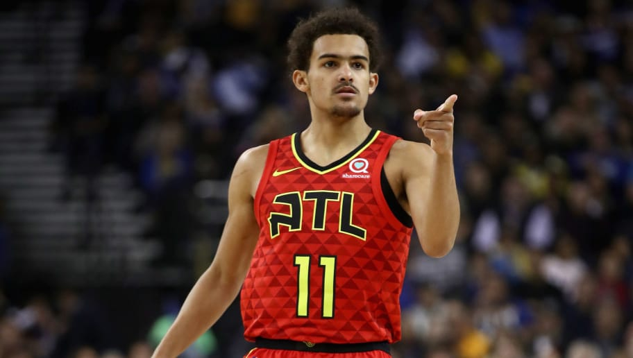 OAKLAND, CA - NOVEMBER 13:  Trae Young #11 of the Atlanta Hawks reacts after the Hawks made a basket against the Golden State Warriors at ORACLE Arena on November 13, 2018 in Oakland, California.  NOTE TO USER: User expressly acknowledges and agrees that, by downloading and or using this photograph, User is consenting to the terms and conditions of the Getty Images License Agreement.  (Photo by Ezra Shaw/Getty Images)