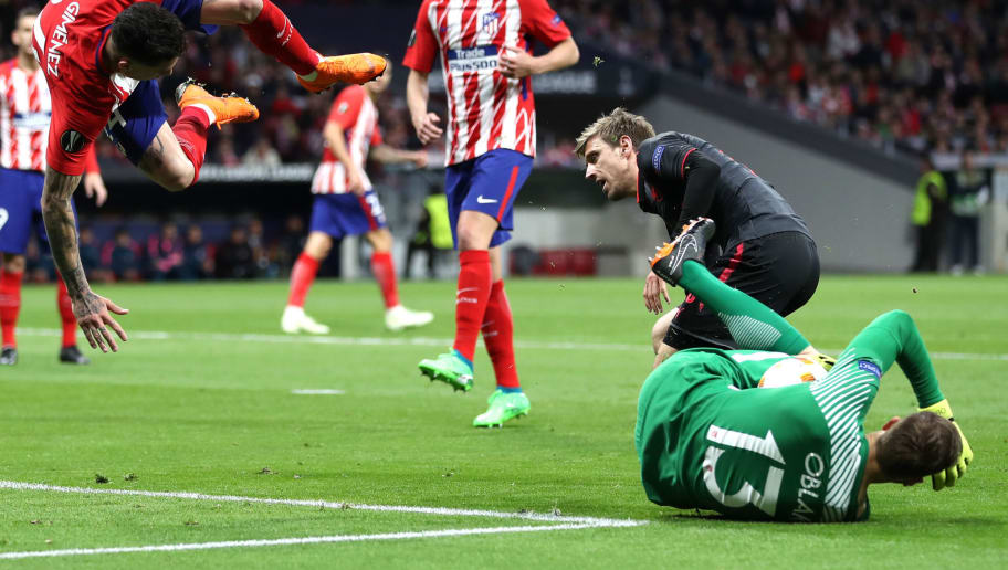 MADRID, SPAIN - MAY 03:  Jose Maria Gimenez of Atletico Madrid goes over Jan Oblak of Atletico Madrid  during the UEFA Europa League Semi Final second leg match between Atletico Madrid  and Arsenal FC at Estadio Wanda Metropolitano on May 3, 2018 in Madrid, Spain.  (Photo by Lars Baron/Getty Images)