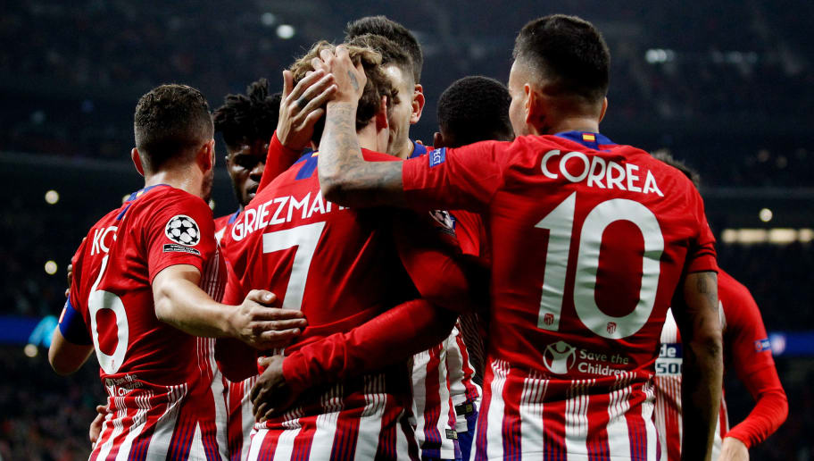 MADRID, SPAIN - NOVEMBER 28: Antoine Griezmann of Atletico Madrid celebrates 2-0 with Koke of Atletico Madrid, Angel Correa of Atletico Madrid  during the UEFA Champions League  match between Atletico Madrid v AS Monaco at the Estadio Wanda Metropolitano on November 28, 2018 in Madrid Spain (Photo by David S. Bustamante/Soccrates/Getty Images)
