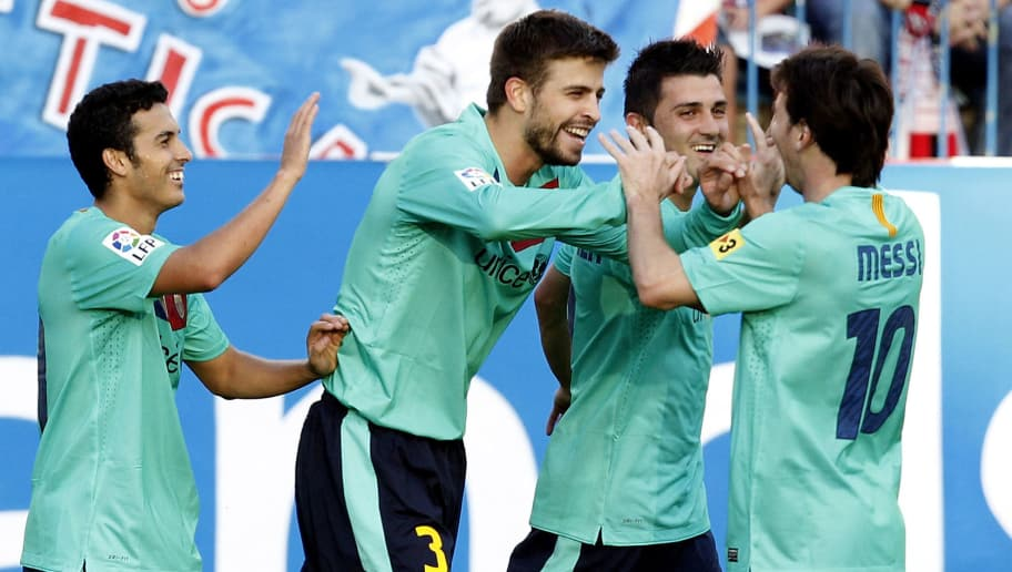 MADRID, SPAIN - SEPTEMBER 19: Gerard Pique (C) of Barcelona celebrates after scoring Barcelona's second goal with Lionel Messi and David Villa during the La Liga match between Atletico Madrid and Barcelona at Vicente Calderon Stadium on September 19, 2010 in Madrid, Spain. (Photo by Angel Martinez/Getty Images)