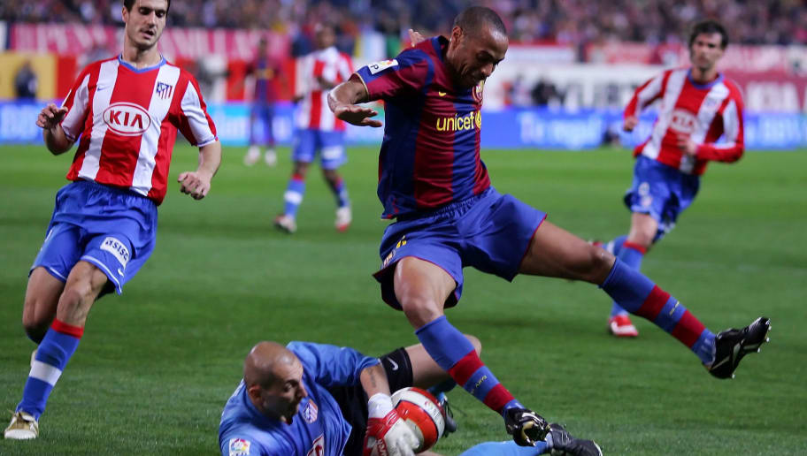 MADRID, SPAIN - MARCH 01: Thierry Henry (R) of Barcelona tries to take the ball off Christian Abbiati of Atletico Madrid during the La Liga match between Atletico Madrid and Barcelona at the Vicente Calderon stadium on March 1, 2008 in Madrid, Spain.  (Photo by Denis Doyle/Getty Images)
