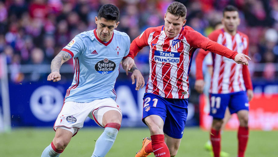 MADRID, SPAIN - MARCH 11: Pedro Pablo Hernandez of RC Celta de Vigo (L) fights for the ball with Kevin Gameiro of Atletico de Madrid (R) during the La Liga 2017-18 match between Atletico de Madrid and RC Celta de Vigo at Wanda Metropolitano on March 11 2018 in Madrid, Spain. (Photo by Power Sport Images/Getty Images)