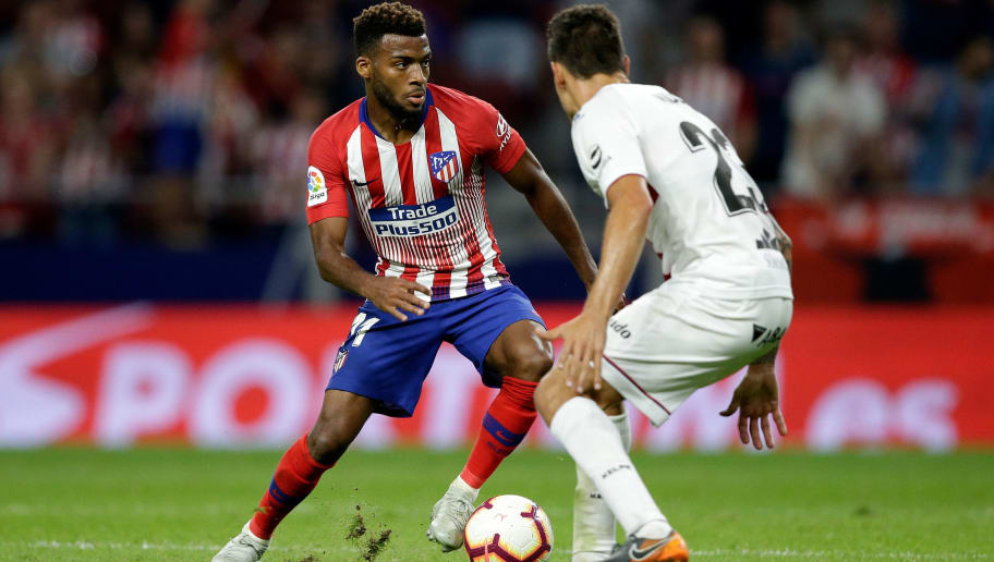 MADRID, SPAIN - SEPTEMBER 25: (L-R) Thomas Lemar of Atletico Madrid, Damian Musto of SD Huesca during the La Liga Santander  match between Atletico Madrid v SD Huesca at the Estadio Wanda Metropolitano on September 25, 2018 in Madrid Spain (Photo by Jeroen Meuwsen/Soccrates/Getty Images)