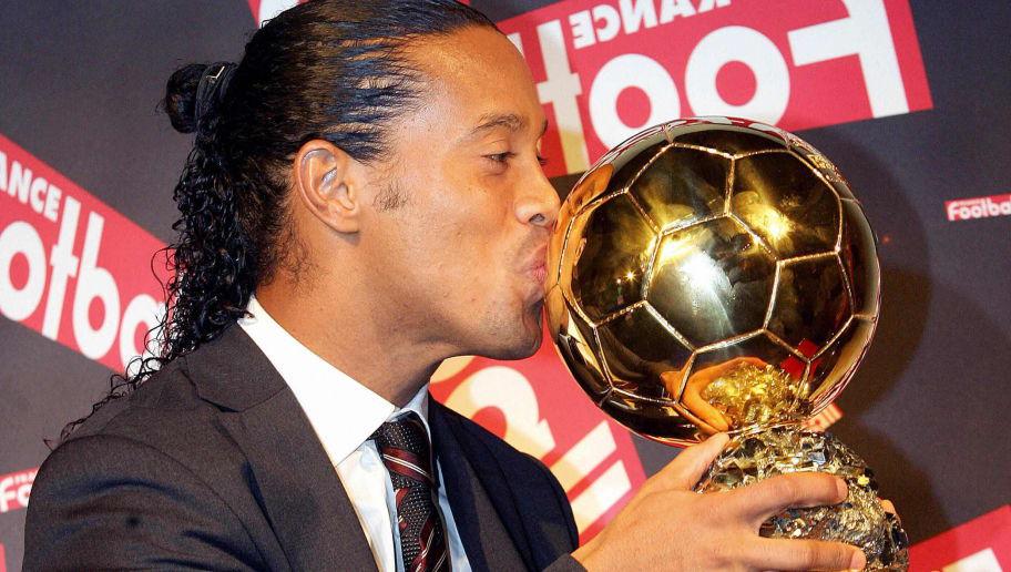 Paris, FRANCE:  ATTENTION EMBARGO - DO NOT USE BEFORE 1930GMT - DO NOT USE BEFORE 1930GMT Brazilian Barcelona midfielder Ronaldinho poses with his trophy after being awarded as 50th Ballon d'Or (Golden Ball), for best football player of the year, 28 November 2005 in Paris. Ronaldinho becomes the third Brazilian to win the award after compatriots Ronaldo in 1997 and 2002, and Rivaldo in 1999.     AFP PHOTO FRANCK FIFE  (Photo credit should read FRANCK FIFE/AFP/Getty Images)
