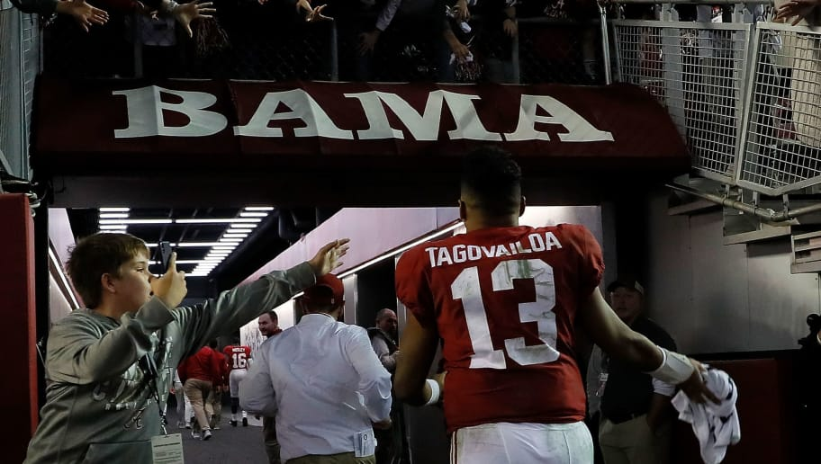 TUSCALOOSA, AL - NOVEMBER 24:  Tua Tagovailoa #13 of the Alabama Crimson Tide rushes off the field after their 52-21 win over the Auburn Tigers at Bryant-Denny Stadium on November 24, 2018 in Tuscaloosa, Alabama.  (Photo by Kevin C. Cox/Getty Images)