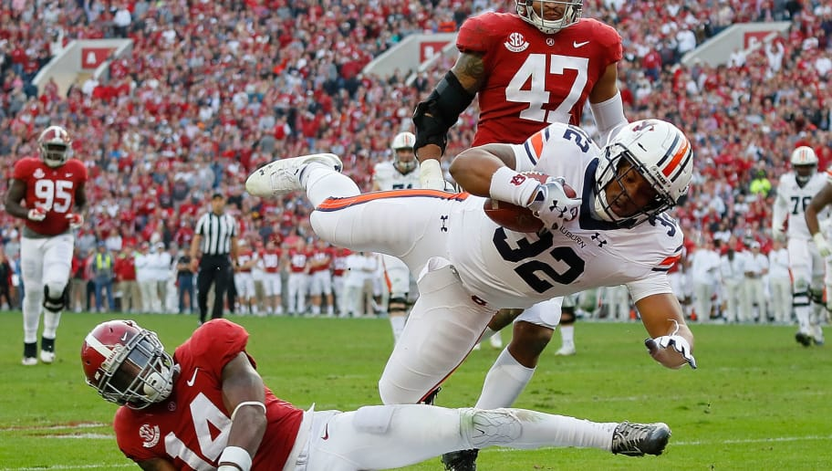 TUSCALOOSA, AL - NOVEMBER 24:  Malik Miller #32 of the Auburn Tigers dives for a touchdown over Deionte Thompson #14 of the Alabama Crimson Tide at Bryant-Denny Stadium on November 24, 2018 in Tuscaloosa, Alabama.  (Photo by Kevin C. Cox/Getty Images)