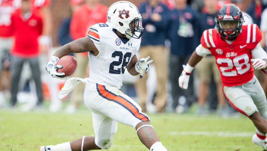OXFORD, MS - OCTOBER 20: Running back JaTarvious Whitlow #28 of the Auburn Tigers looks to run the ball by Tylan Knight #28 of the Mississippi Rebels during the second half at Vaught-Hemingway Stadium on October 20, 2018 in Oxford, Mississippi. (Photo by Michael Chang/Getty Images)