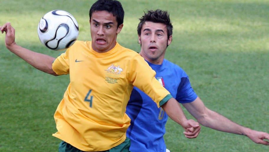 Australian midfielder Tim Cahill (L) vie
