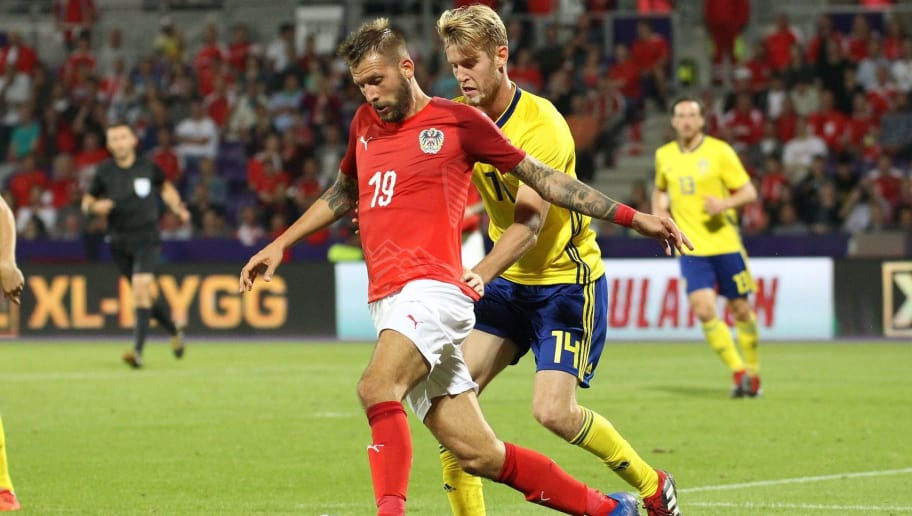 VIENNA, AUSTRIA - SEPTEMBER 6: Guido Burgstaller of Austria and Filip Helander of Sweden during the internationl friendly match between Austria and Sweden at Generali Arena on September 6, 2018 in Vienna, Austria. (Photo by Michael Baldauf/SEPA.Media /Getty Images)
