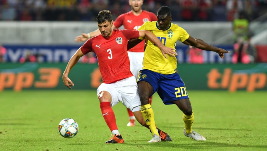 VIENNA, AUSTRIA - SEPTEMBER 6: Aleksandar Dragovic of Austria is challenged by Ken Sema of Sweden during the international friendly match between Austria and Sweden at Generali-Arena on September 6, 2018 in Vienna, Austria. (Photo by Andrea Kareth /SEPA.Media /Getty Images)