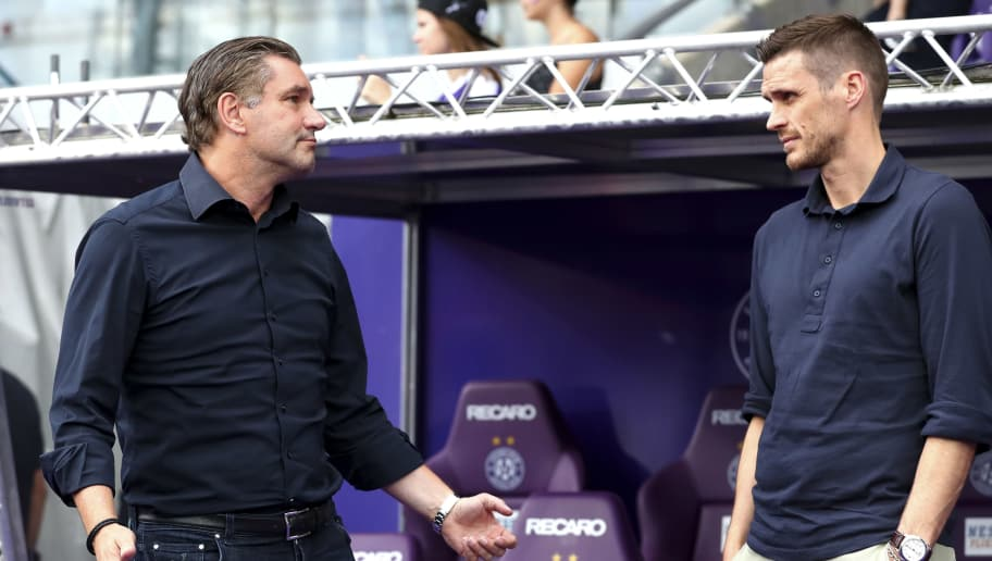VIENNA, AUSTRIA - JULY 13: Michael Zorc of Dortmund speak with Sebastian Kehl of Dortmund during the friendly match between Austria Wien and Borussia Dortmund at Generali Arena on July 13, 2018 in Vienna, Austria. (Photo by TF-Images/Getty Images)