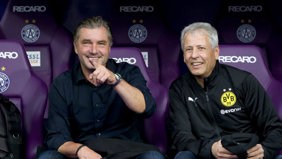 VIENNA, AUSTRIA - JULY 13: Sporting director Michael Zorc of Dortmund and Head coach Lucien Favre of Dortmund look on prior to the friendly match between Austria Wien and Borussia Dortmund at Generali Arena on July 13, 2018 in Vienna, Austria. (Photo by TF-Images/Getty Images)