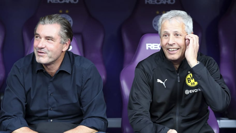 VIENNA, AUSTRIA - JULY 13: Michael Zorc of Dortmund and Head coach Lucien Favre of Dortmund look on prior the friendly match between Austria Wien and Borussia Dortmund at Generali Arena on July 13, 2018 in Vienna, Austria. (Photo by TF-Images/Getty Images)