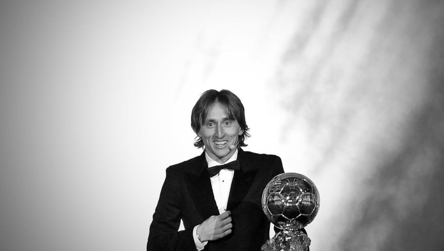 PARIS, FRANCE - DECEMBER 03: (EDITOR'S NOTE: This image was converted to black and white)  Luka Modric of Croatia and Real Madrid wins the 2018 Ballon D'Or at Le Grand Palais on December 3, 2018 in Paris, France.  (Photo by Aurelien Meunier/Getty Images)