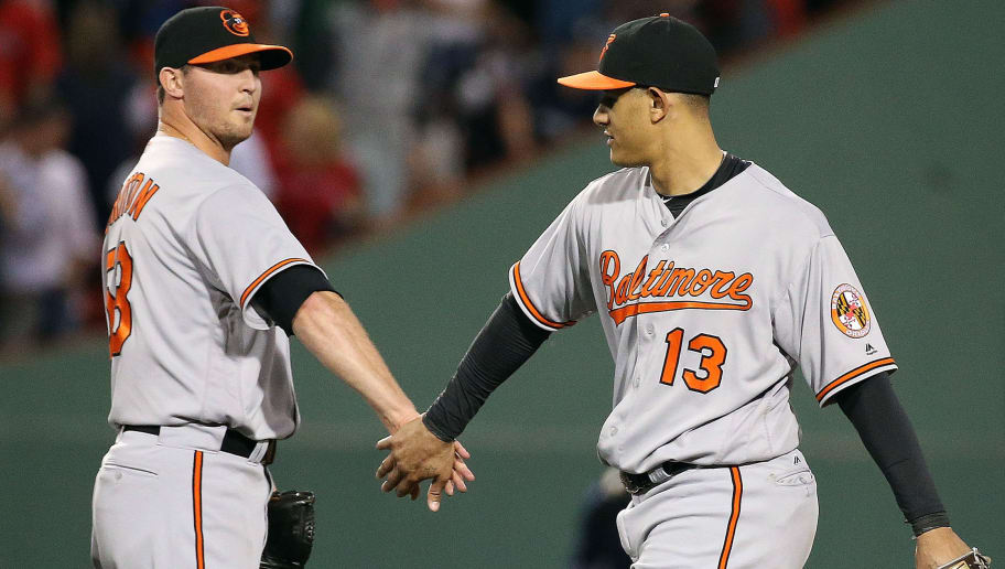 BOSTON, MA - JUNE 14:  Manny Machado #13 of the Baltimore Orioles and Zach Britton #53 celebrate a win against the Boston Red Sox at Fenway Park on June 14, 2016 in Boston, Massachusetts.  (Photo by Jim Rogash/Getty Images)