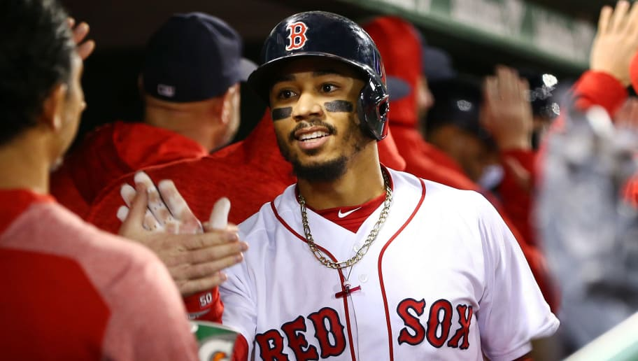 BOSTON, MA - SEPTEMBER 24:  Mookie Betts #50 of the Boston Red Sox returns to the dugout after hitting a two-run home run in the second inning of a game against the Baltimore Orioles at Fenway Park on September 24, 2018 in Boston, Massachusetts.  (Photo by Adam Glanzman/Getty Images)