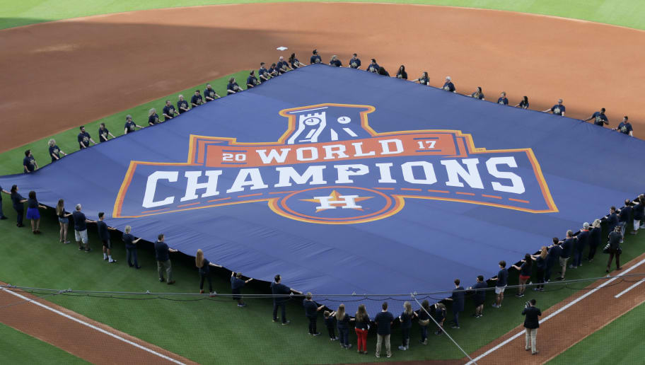HOUSTON, TX - APRIL 02:  Houston Astros display a 2017 World Series Championship banner fduring pre-game ceremonies on Opening Day at Minute Maid Park on April 2, 2018 in Houston, Texas.  (Photo by Bob Levey/Getty Images)