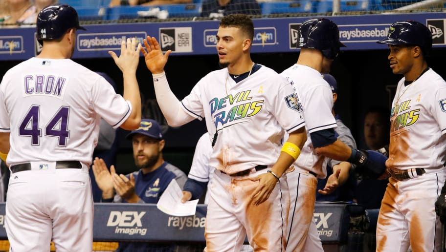 ST. PETERSBURG, FL  SEPTEMBER 8: Willy Adames #1 of the Tampa Bay Rays welcome teammate C.J. Cron #44 after Cron scored on a single by Matt Duffy #5 during the seventh inning of the game against the Baltimore Orioles at Tropicana Field on September 8, 2018 in St. Petersburg, Florida. (Photo by Joseph Garnett Jr./Getty Images)