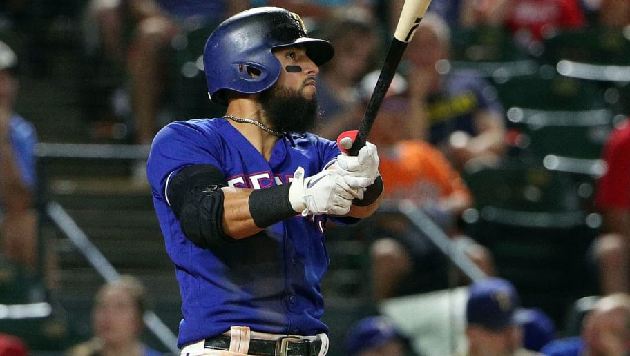 ARLINGTON, TX - AUGUST 04:  Rougned Odor #12 of the Texas Rangers watches his home run shot in the eighth inning against the Baltimore Orioles at Globe Life Park in Arlington on August 4, 2018 in Arlington, Texas.  (Photo by Richard Rodriguez/Getty Images)