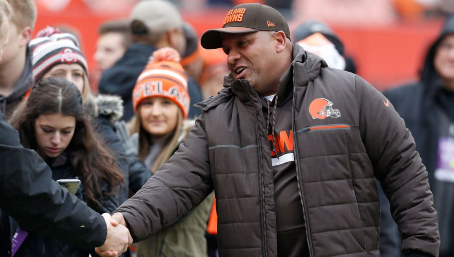 CLEVELAND, OH - DECEMBER 17:  Head coach Hue Jackson of the Cleveland Browns shakes hands with a fan prior to the start of the game against the Baltimore Ravens at FirstEnergy Stadium on December 17, 2017 in Cleveland, Ohio. (Photo by Kirk Irwin/Getty Images)  *** Hue Jackson