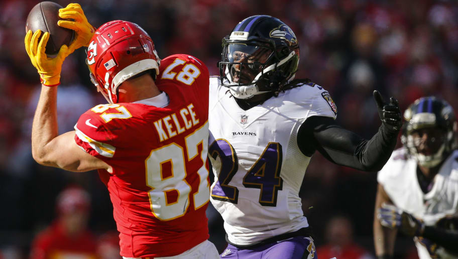 KANSAS CITY, MO - DECEMBER 09: Cornerback Brandon Carr #24 of the Baltimore Ravens defends a pass catch made by tight end Travis Kelce #87 of the Kansas City Chiefs in the first quarter at Arrowhead Stadium on December 9, 2018 in Kansas City, Missouri. (Photo by David Eulitt/Getty Images)