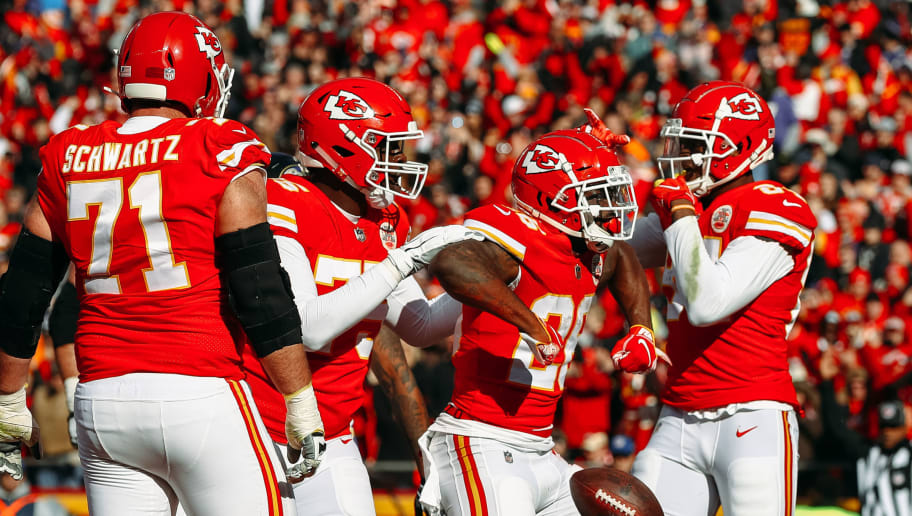 KANSAS CITY, MO - DECEMBER 9: Damien Williams #26 of the Kansas City Chiefs celebrates his first touchdown as a chief after scoring the games first points during the first quarter of the game against the Baltimore Ravens at Arrowhead Stadium on December 9, 2018 in Kansas City, Missouri. (Photo by Jamie Squire/Getty Images)