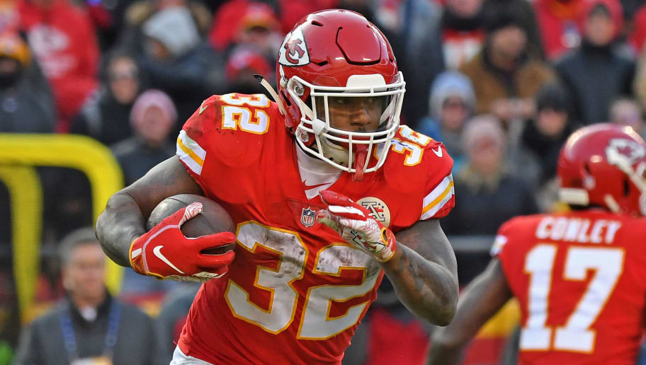 KANSAS CITY, MO - DECEMBER 09:  Running back Spencer Ware #32 of the Kansas City Chiefs rushes up field against the Baltimore Ravens during the second half on December 9, 2018 at Arrowhead Stadium in Kansas City, Missouri.  (Photo by Peter G. Aiken/Getty Images)