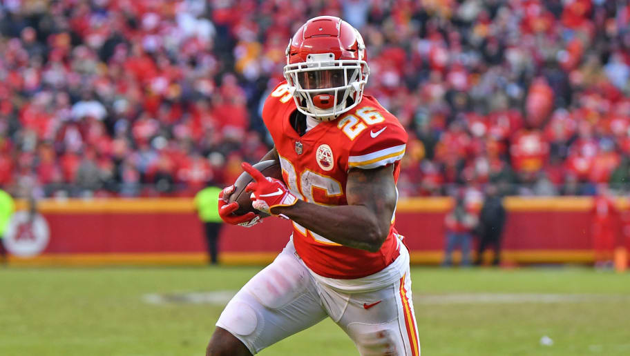 KANSAS CITY, MO - DECEMBER 09:  Running back Damien Williams #26 of the Kansas City Chiefs rushes for a touchdown against the Baltimore Ravens during the second half on December 9, 2018 at Arrowhead Stadium in Kansas City, Missouri.  (Photo by Peter G. Aiken/Getty Images)