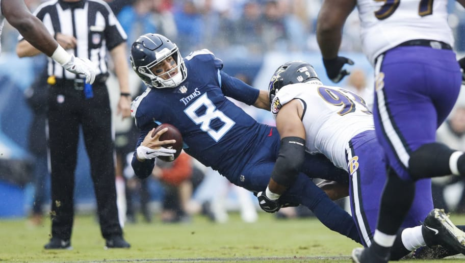 NASHVILLE, TN - OCTOBER 14: Marcus Mariota #8 of the Tennessee Titans is tackled with the ball by Chris Wormley #93 of the Baltimore Ravens during the first quarter at Nissan Stadium on October 14, 2018 in Nashville, Tennessee. (Photo by Joe Robbins/Getty Images)
