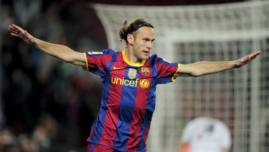 Barcelona's Argentinian defender Gabriel Milito celebrates his goal during the Spanish King's Cup (Copa del Rey) football match Barcelona against Ceuta on November 10, 2010 at the Camp Nou stadium in Barcelona.    AFP PHOTO/ JOSEP LAGO (Photo credit should read JOSEP LAGO/AFP/Getty Images)