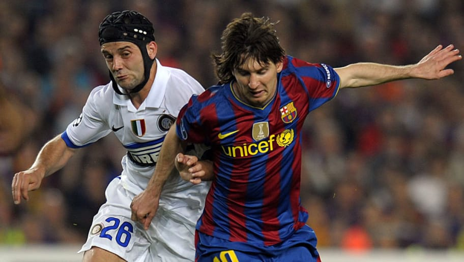 Barcelona's Argentinian forward Lionel Messi (R) vies with Inter Milan's Romanian defender Cristian Chivu (L) during the UEFA Champions League semi-final second leg football match Barcelona vs Inter Milan on April 28, 2010 at the Camp Nou stadium in Barcelona. AFP PHOTO/LLUIS GENE (Photo credit should read LLUIS GENE/AFP/Getty Images)