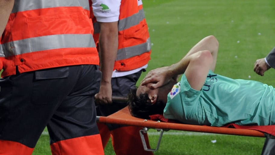 Barcelona's Argentinian forward Lionel Messi leaves the field injured on a stretcher during a Spanish League football match between Atletico de Madrid and Barcelona at Vicente Calderon stadium in Madrid on September 19, 2010. Barcelona won 1-2. AFP PHOTO / DOMINIQUE FAGET (Photo credit should read DOMINIQUE FAGET/AFP/Getty Images)