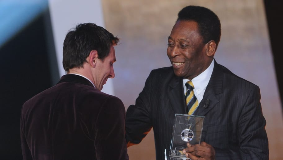 Barcelona's Argentinian forward Lionel Messi (L) receives from Brazilian football legend Pele the FIFA/FIFPro World XI award on January 9, 2012 at the Kongresshaus in Zurich during the FIFA Ballon d'Or event.      AFP PHOTO / FRANCK FIFE (Photo credit should read FRANCK FIFE/AFP/Getty Images)