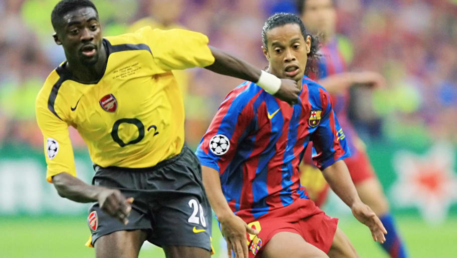Saint-Denis, FRANCE:  Barcelona's Brazilian forward Ronaldinho (R) vies with Arsenal's Ivorian defender Kolo Abib Toure during the UEFA Champion's League final football match Barcelona vs. Arsenal, 17 May 2006 at the Stade de France in Saint-Denis, northern Paris.  AFP PHOTO ODD ANDERSEN  (Photo credit should read ODD ANDERSEN/AFP/Getty Images)