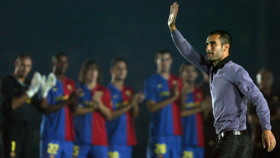Barcelona's coach Josep Guardiola waves to his fans as his players applaud during an official presentation in their 43th Trophy Joan Gamper friendly football match against Boca Juniors at Camp Nou stadium in Barcelona, on August 16, 2008. AFP PHOTO/JOSEP LAGO. (Photo credit should read JOSEP LAGO/AFP/Getty Images)